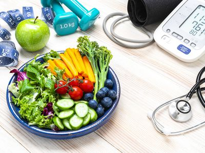 healthy food with blood pressure cuff