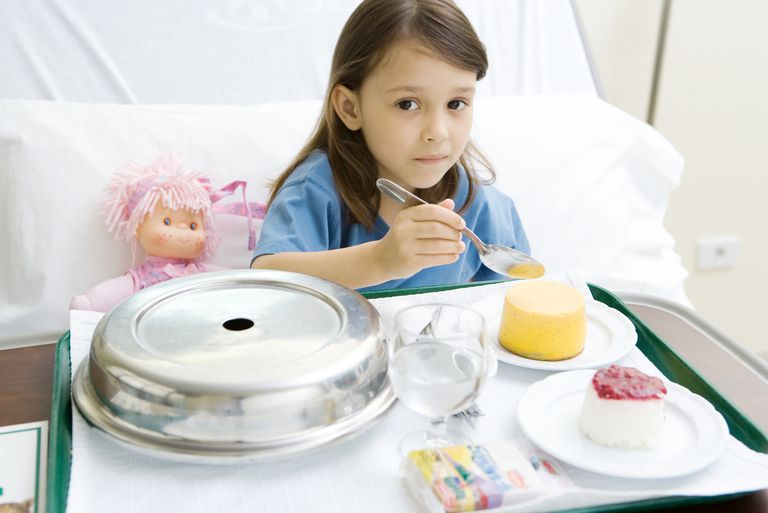 Girl eating soft food after surgery.