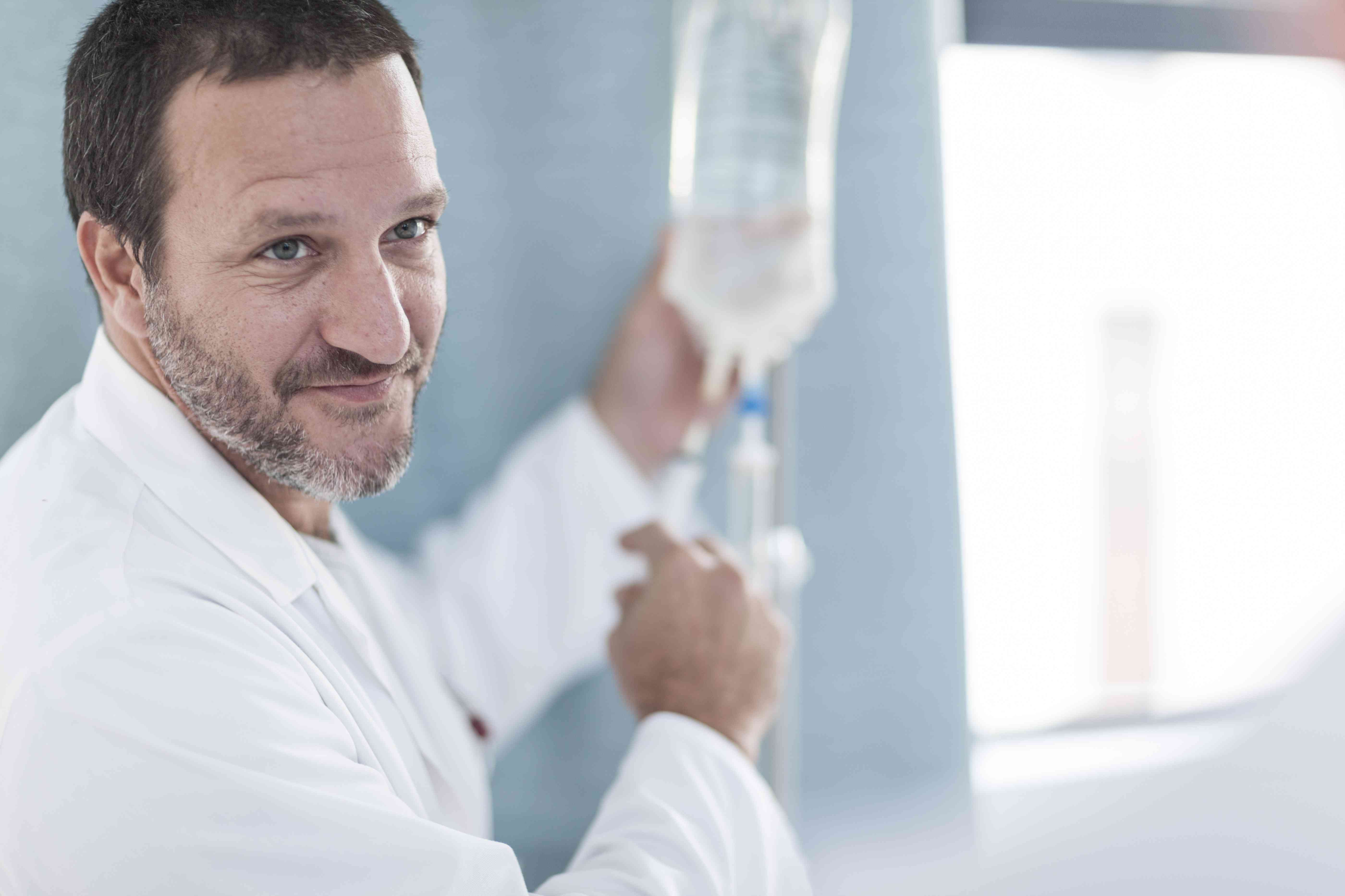 A doctor performing chelation therapy