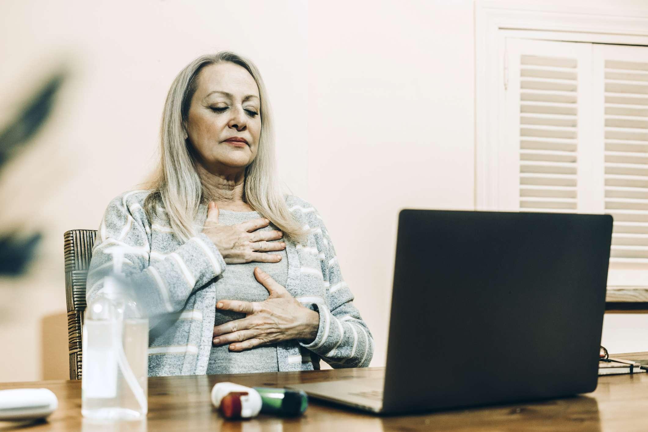 Older woman practicing breathing