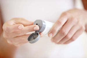 woman using hand lotion