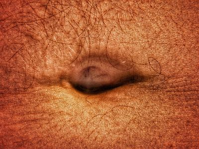 Close-Up Of Man Belly Button - stock photo