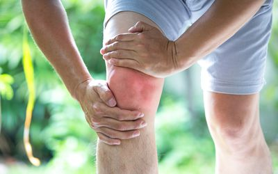Man holding his painful knee