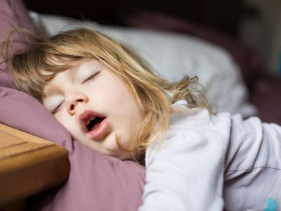 Young girl snoring while she sleeps