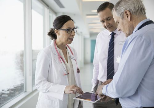 Healthcare professionals speak together
