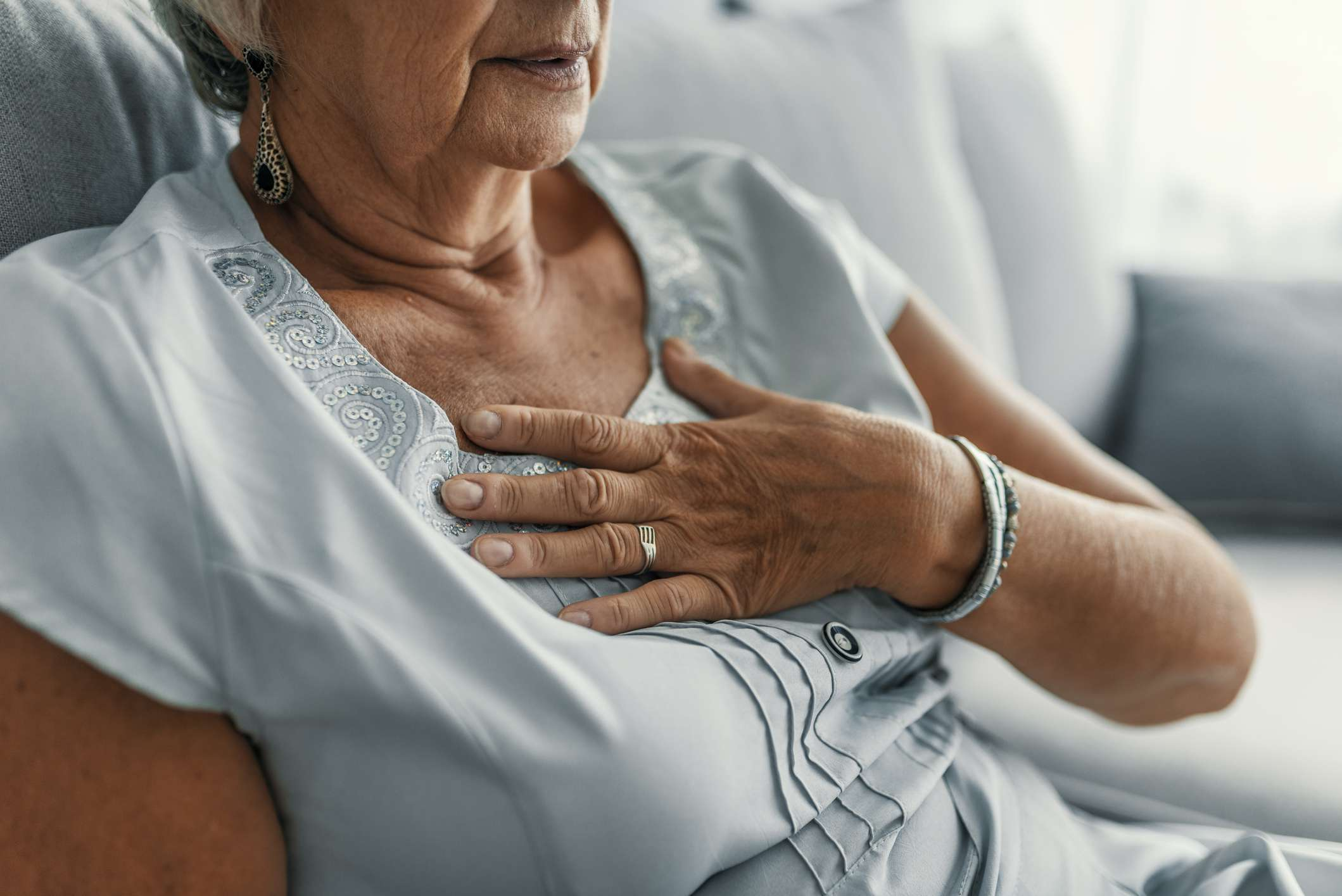 a woman clutching her chest in pain