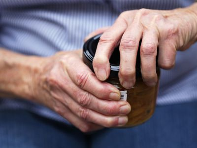 Senior opening jar with arthritic hands