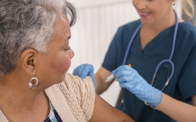 Nurse giving immunomodulator injection to patient
