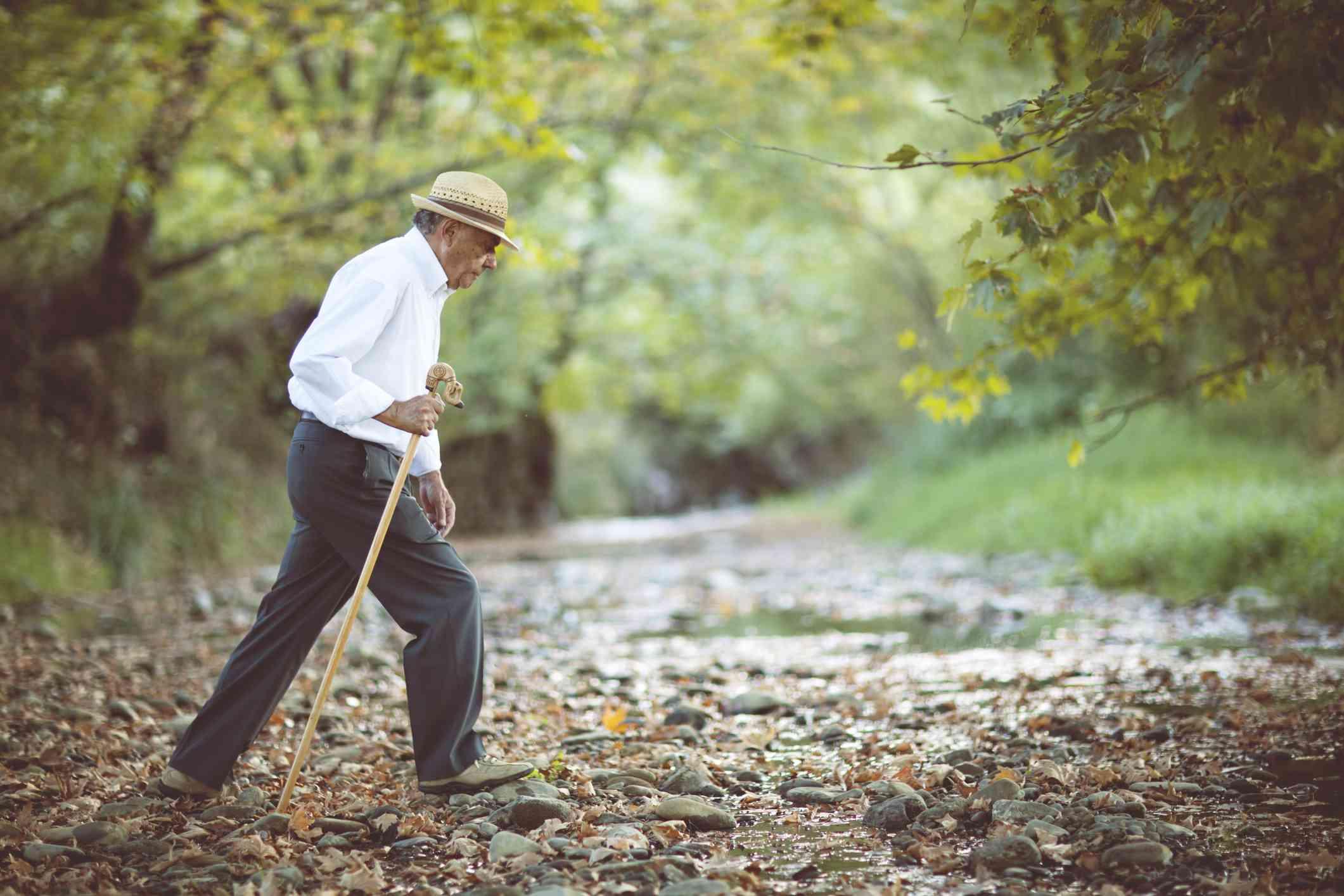 Older man walking in woods