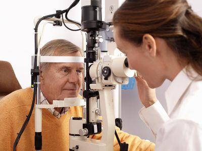 Senior man having eye exam