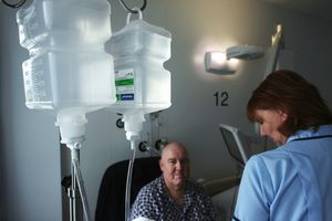 Nurse helping patient with chemotherapy