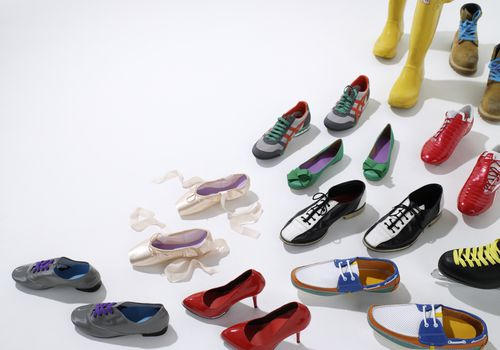 variety of shoes set up on a white background