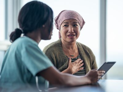 Asian woman with cancer meeting with female physician