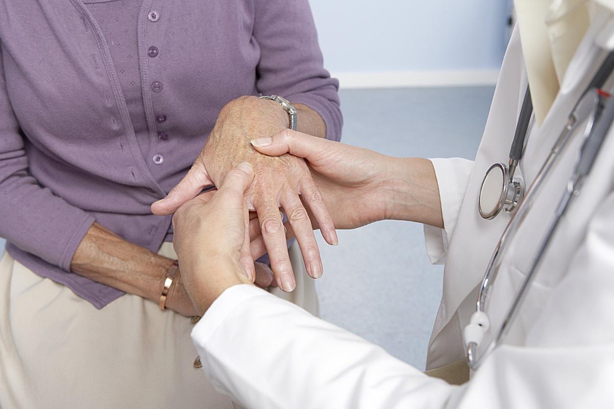 Doctor examining hands
