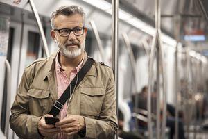 Thoughtful man listening music in subway train