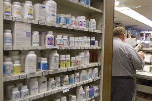 Behind the counter at a pharmacy