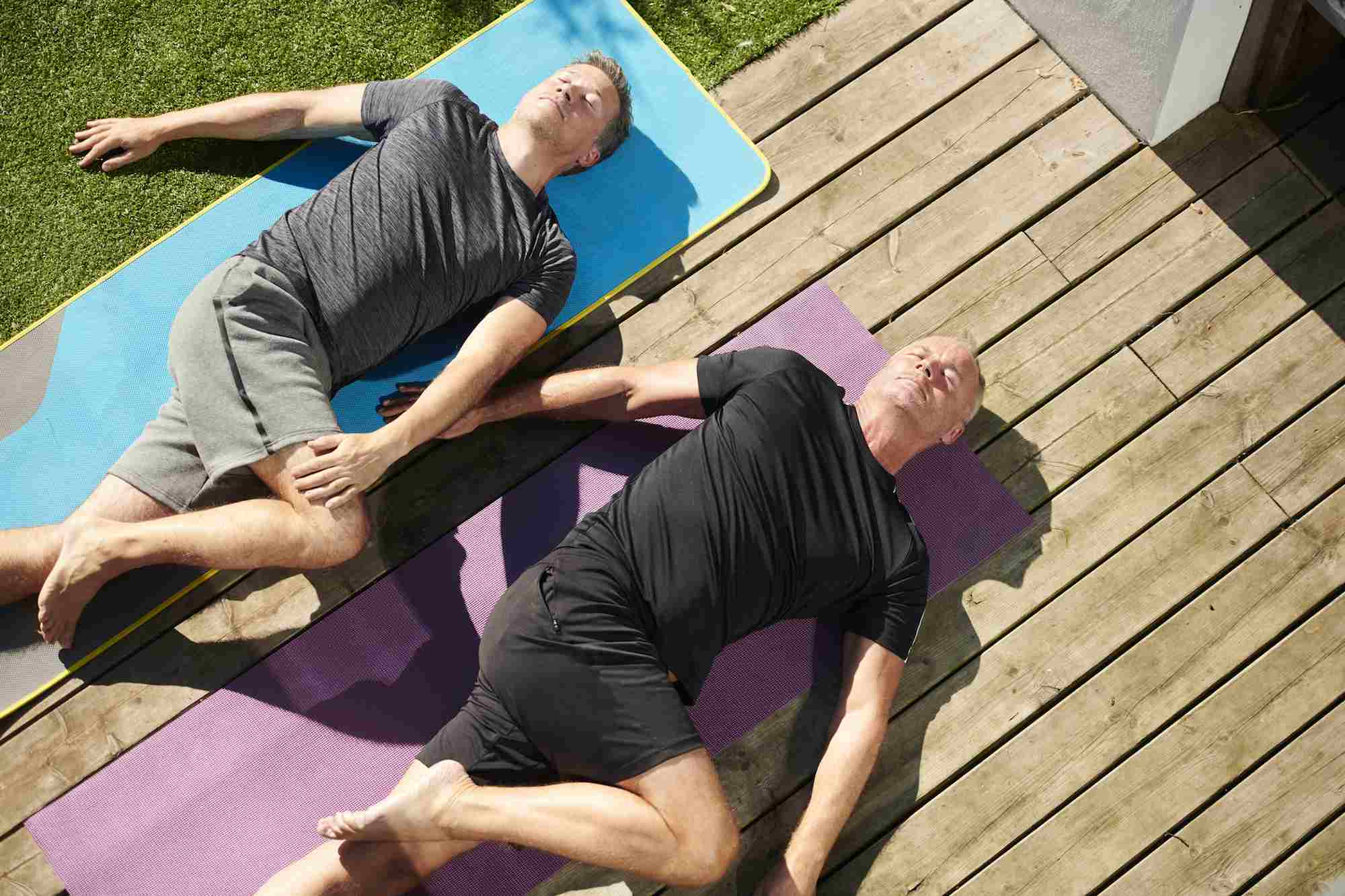 Two men doing yogas