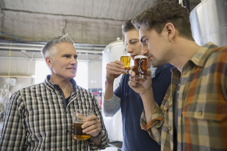 Men tasting beer at brewery