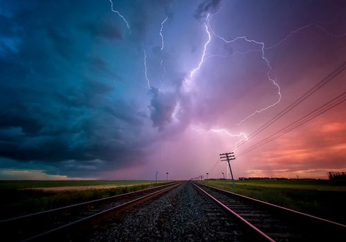 Lightening over a train track