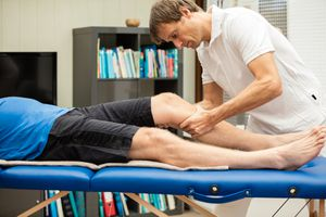 Doctor testing the knee with the Lachman Test
