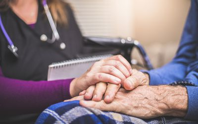 Hospice worker comforting client