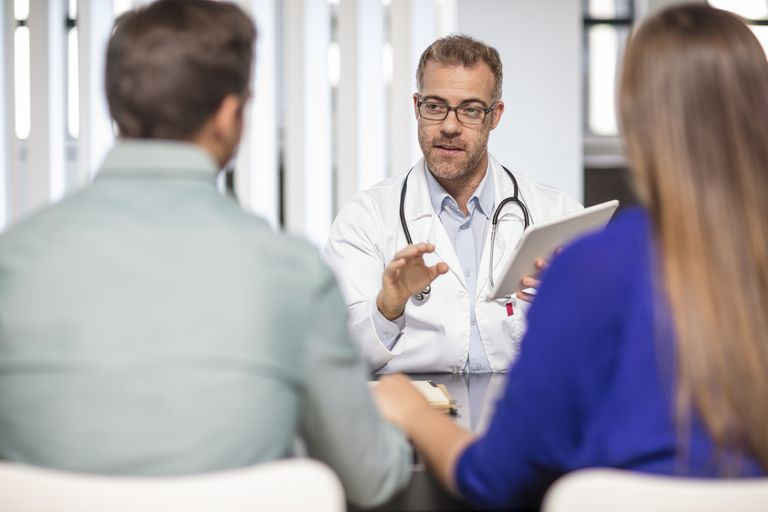 A doctor talking to a couple