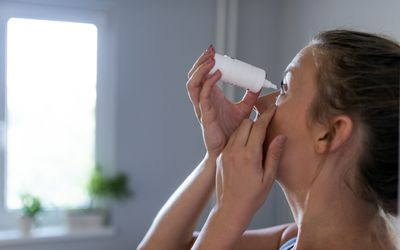 a woman taking care of her eyes