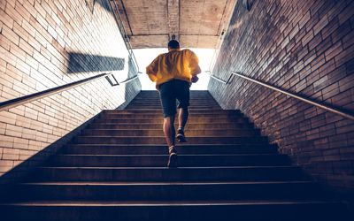 man jogging up stairs
