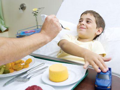 Boy eating in a hospital