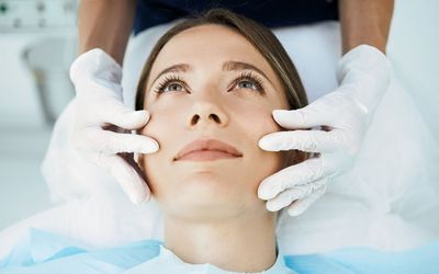 Cosmetologist preparing for facial treatments