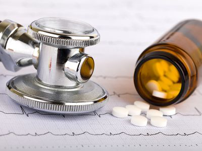stethoscope and white pill capsules