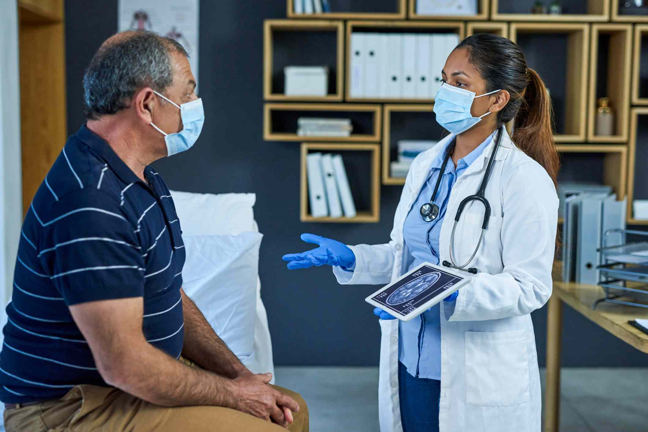 Doctor discusses MRI with patient