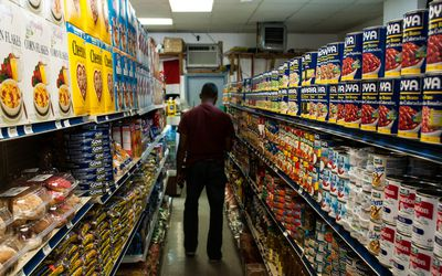 A man in an aisle at the market