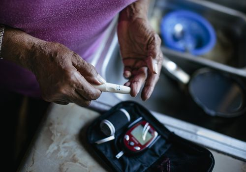 Woman checking her blood sugar levels.