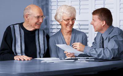 Couple receiving tax advice.
