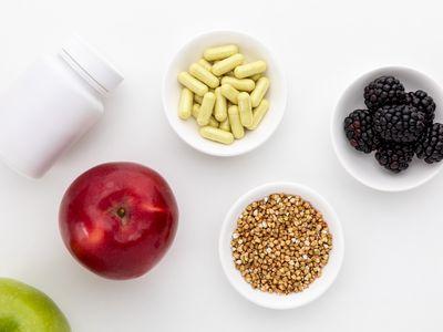 Quercetin capsules, blackberries, apples, and buckwheat