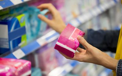woman shopping for pads