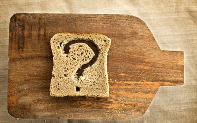 slice of bread with a question mark cut into it