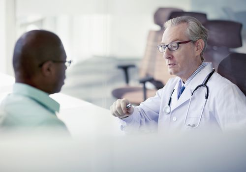 man consulting with doctor