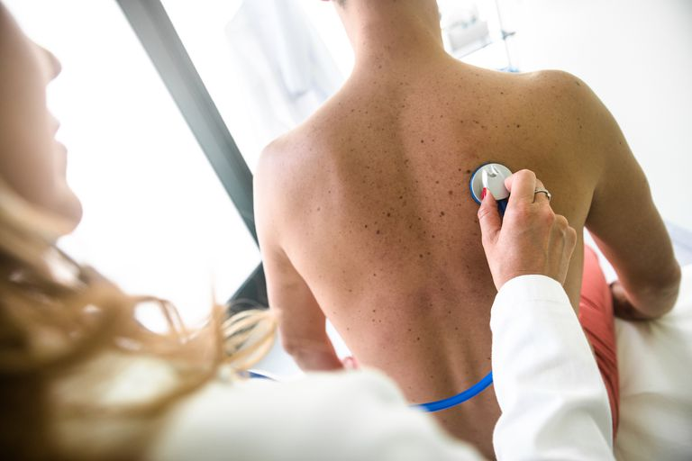 Doctor with stethoscope doing exam