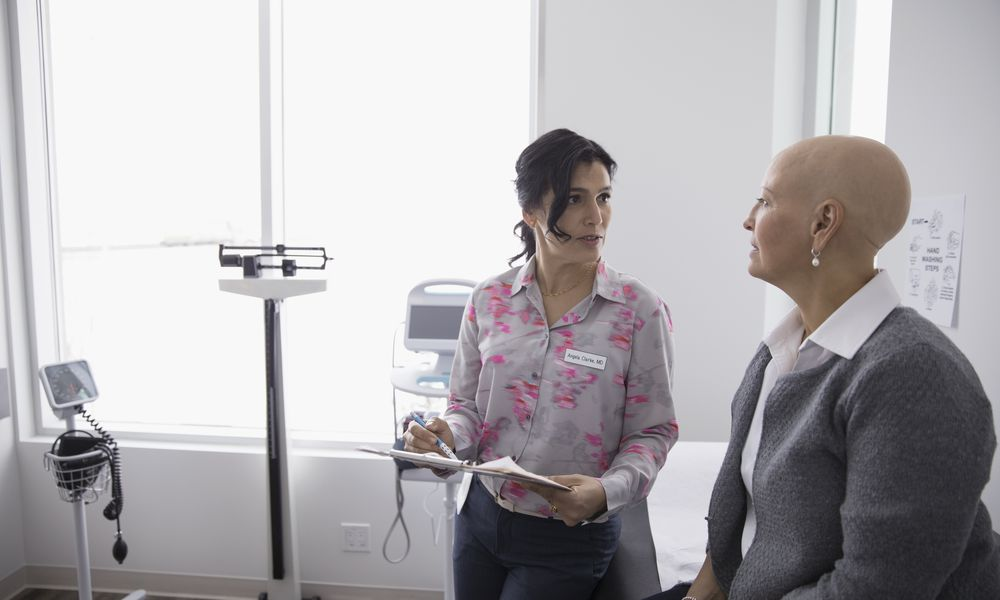 Woman with cancer talking with her doctor