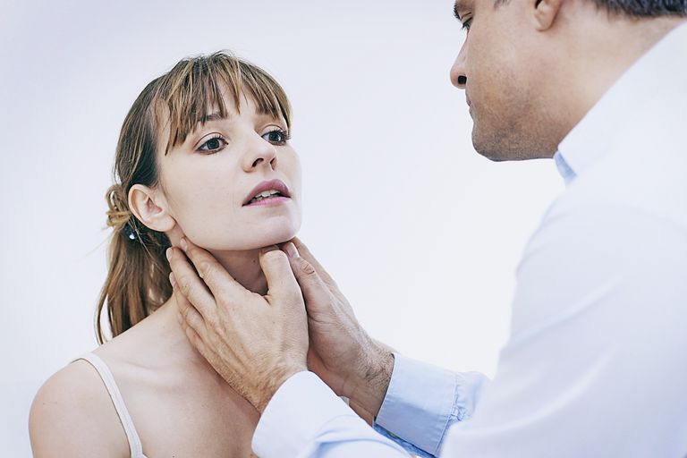 doctor palpating woman's lymph nodes