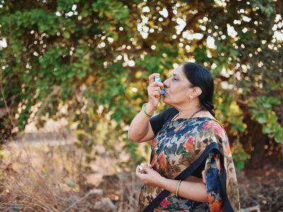 Woman using an inhaler for COPD