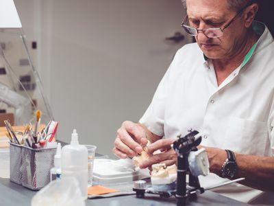 Lab worker working on a dental impression