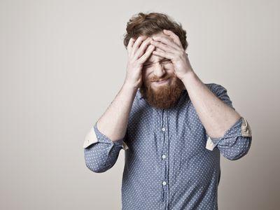 Man stressed out clutching his head
