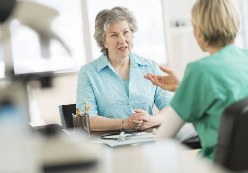 older female patient talking to doctor