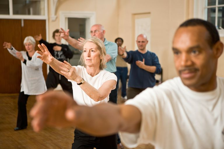 a group of people doing Tai Chi
