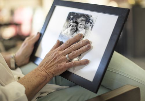 Grieving woman looking over photograph