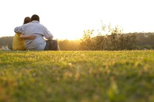 Overweight couple embraces on a field