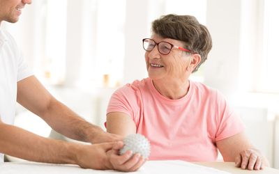 Older woman in hand physiotherapy